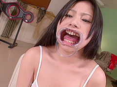 Japanese Young Chick Swallows Hot Jizz Wearing A Mouth Opener